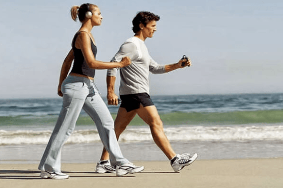 walking exercise by the beach