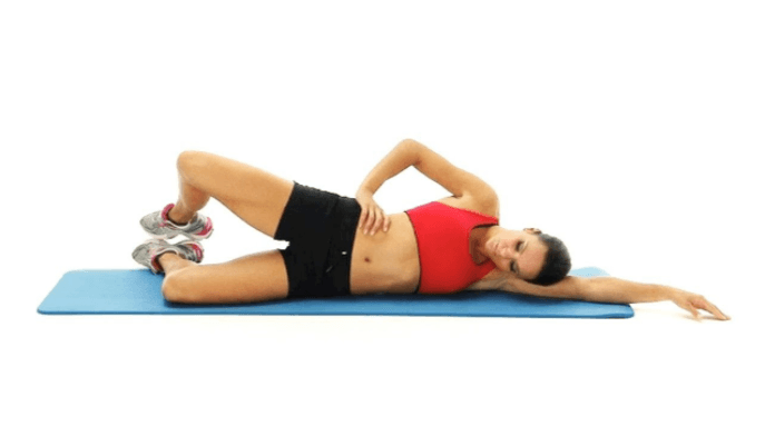 woman doing the clamshell exercise