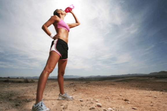 woman drinking on a run break