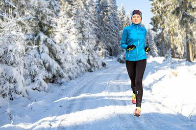 Girl Running in Cold Weather on Snowy Trail
